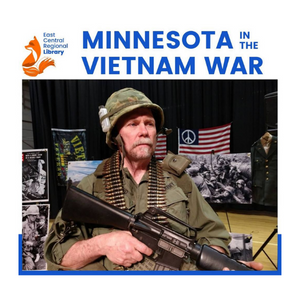 Presenter Arn Kind wears an American's uniform from the Vietnam War while standing in front of his multimedia display